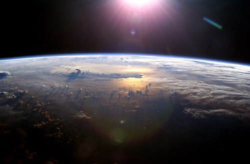 The sun rising over the earth